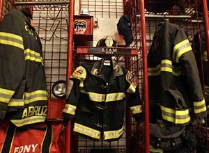 AP Photo/Kathy WillensA miniature firefighter's jacket and helmet belonging to six year-old cancer victim Liam Witt hangs beside its adult-sized equivalents at Engine Co. 1 and Ladder Co. 24in New York prior to a memorial service for Witt on Monday.