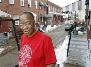 AP Photo/Keith SrakocicSharon Edge stands by the house in Pittsburgh last month where she and her late boyfriend, Curtis Mitchell, lived.