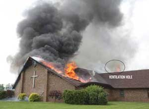 Photo Star Press/NIOSHThe roof of the church has collapsed into the sanctuary after the steeple fell on top of it. Note the fire blowing from the ventilation hole.