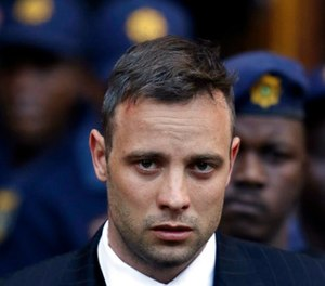 In this June 15, 2016, file photo, Oscar Pistorius leaves the High Court in Pretoria, South Africa, after his sentencing proceedings. (AP Photo/Themba Hadebe, File)