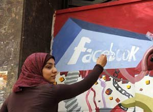 AP Photo/Manoocher DeghatiAn art student from the University of Helwan paints the Facebook logo on a mural commemorating the revolution that overthrew Hosni Mubarak. Dave Konig argues that you can either be like the Egyptian protesters who embraced and used social media, or the leadership that ignored it.