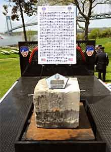 Photo FDNYThe stone is displayed in front of pictures of fallen 9/11 firefighters.