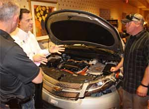 Photo Jamie ThompsonKeith Schultz, senior manager of GM Hybrid and Electric Vehicle Engineering, displays a crashed and extricated Chevrolet Volt in a presentation on hybrid and electric vehicles at Fire-Rescue Med in Las Vegas on Wednesday.