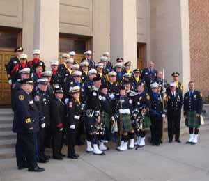 Photo Jules ScaddenThe EMS National Memorial Service Honor Guard and Bag Pipers stand in front of the First Presbyterian Church in Colorado Springs.