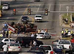 Photo Jared Soares / The Roanoke TimesResponders block off the crash site.