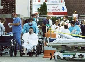 AP Photo/The Standard Times, Andrew T. GallagherMedical personnel tend to people outside St. Luke's Hospital on Monday.