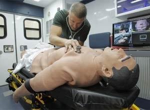 Photo Rodger Mallison/Star-TelegramRonnie Ikeler, EMS specialist for HCA North Texas, demonstrates iStan, a training manikin in an ambulance simulator.