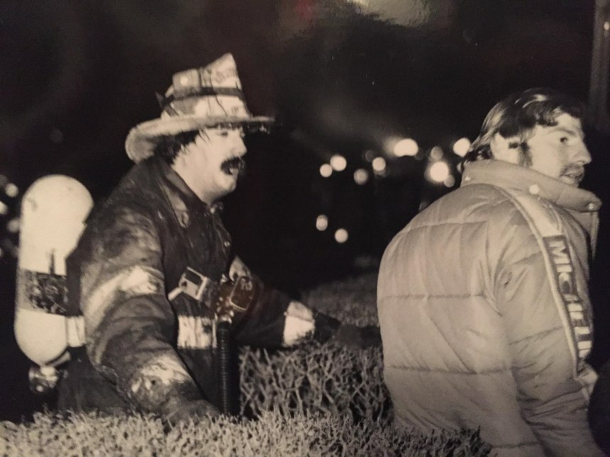 Chief Billy Goldfeder fights an apartment fire in 1979