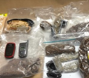 Officials said the women were attempting to smuggle in contraband that contained tobacco, marijuana, cellphones and a pill that tested positive for ecstasy