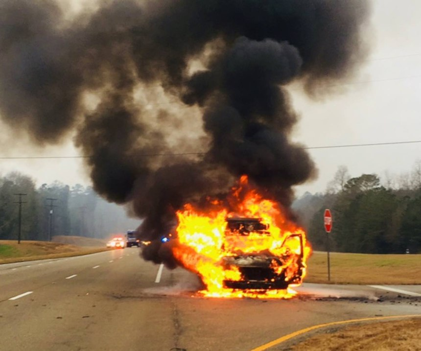An ambulance erupted into flames on a highway after a mechanical failure, according to officials. (Photo/Jones County Fire Council)