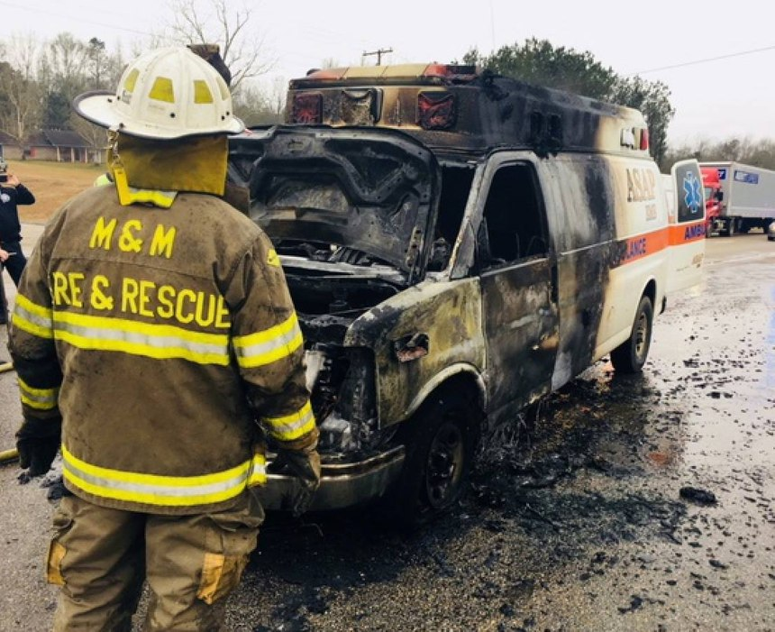 The ASAP Ambulance Service vehicle was driving down the highway when a fire broke out in the engine compartment. (Photo/Jones County Fire Council)