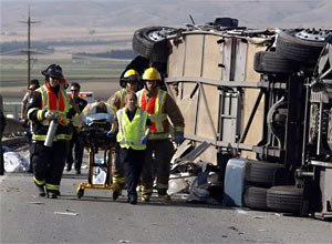 AP Photo/The Monterey County Herald, Vern FisherFirefighters transport an injured passenger at the scene, Tuesday.