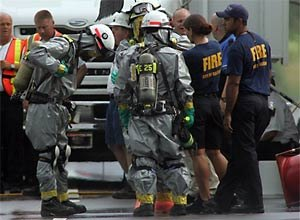 AP Photo/Jim R. Bounds, PoolRescue workers gather atthe food plant after the explosion Tuesday.
