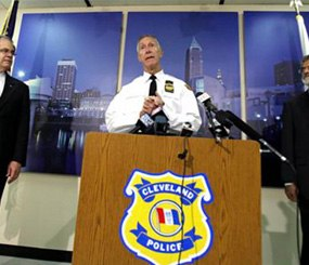 Cleveland Police Chief Michael McGrath, center, announces the results of disciplinary hearings for officers involved in a deadly chase on Oct. 15.