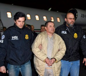 In this Jan. 19, 2017, file photo provided U.S. law enforcement, authorities escort Joaquin