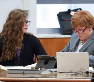Anissa Weier, left, talks to her attorney Maura McMahon during jury selection in the trial to determine 15-year-old Weier's competency at Waukesha County Courthouse Monday, Sept 11, 2017, in Waukesha, Wis. (AP Photo/Morry Gash, Pool)