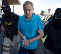 Fugitive Ky. lawyer returns to US after being caught in Honduras