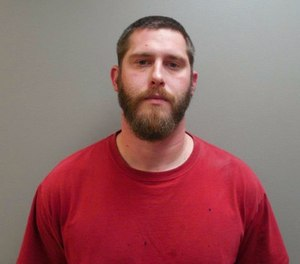 This undated image provide by the Paulding County Sheriff's Office shows Branden Powell. Authorities say a manhunt is under way for Powell, an Ohio rape suspect who overpowered a sheriff's deputy in a transport van and stole his gun and ammunition. (Paulding County Sheriff's Office via AP)