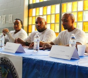 In this June 27, 2017 photo prison inmates Tarrance Lawrence, Ray Boyd and Tino Negron prepare talk a group of federal judges visiting the Osborn Correctional Institution in Somers, Conn. about the Skills of Socialization program. (AP Photo/Pat Eaton-Robb)