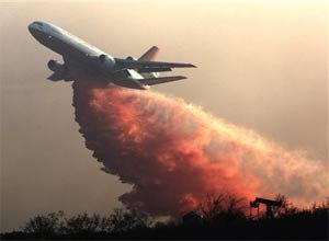 AP Photo/John LazarA DC-10 drops fire retardant over a hillside to battle wildfires in Grimes Canyon in Fillmore, Calif., on Tuesday.