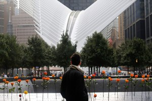 A man looks at the North Pool at the World Trade Center during a ceremony marking the 17th anniversary of the terrorist attacks on the United States. Tuesday, Sept. 11, 2018, in New York. In the background is the World Trade Center Transportation Hub. (AP Photo/Mark Lennihan)