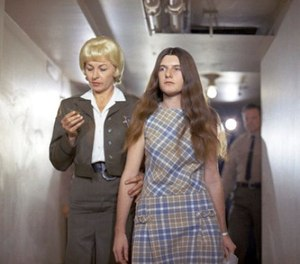 In this Feb. 24, 1970 file photo, Patricia Krenwinkel, a defendant in the Tate murder case, enters the superior court in Los Angeles for an arraignment.
