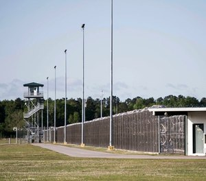 This April 16, 2018 file photo shows the Lee Correctional Institution in Bishopville, S.C. Multiple inmates were killed and others seriously injured amid fighting between prisoners inside the maximum security prison in South Carolina. (AP Photo/Sean Rayford, File)