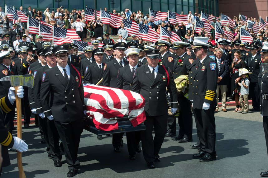 FIn this Aug. 20, 2018, file photo, the casket with fallen Utah firefighter Matthew Burchett is loaded into a fire engine after the funeral at the Maverik Center in West Valley City, Utah. Burchett, a firefighter battling the largest wildfire in California history, was killed last month when thousands of gallons of flame-suppressing liquid were dropped from a Boeing 747 that was mistakenly flying only 100 feet (30 meters) above the treetops, according to an official report Friday, Sept. 14.