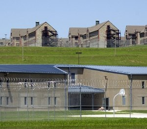 Maximum security housing units at the new Jefferson City Correctional Center sit below dormitory-style housing at a the minimum security Algoa Correctional Center Thursday, June 24, 2004, in Jefferson City, Mo. (AP Photo/Kelley McCall)
