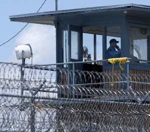 In this photo taken May 13, 2011, a guard is shown in a tower at the Arkansas Department of Correction Tucker Unit near Tucker, Ark.