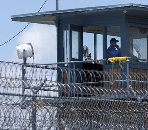 In this photo taken May 13, 2011, a guard is shown in a tower at the Arkansas Department of Correction Tucker Unit near Tucker, Ark. (AP Photo/Danny Johnston)