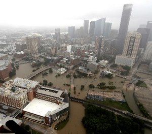 Downtown Houston is surrounded by floodwaters from Tropical Storm Harvey Tuesday, Aug. 29, 2017. (AP Photo/David J. Phillip)