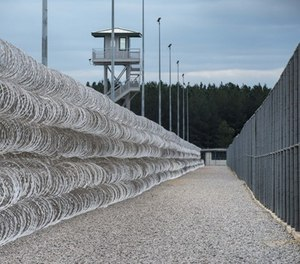 Razor wire protects a perimeter of the Lee Correctional Institution in Bishopville, S.C., Tuesday, Feb. 9, 2016.