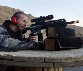 In this Dec. 23, 2012 file photo, Michael Reed, of Cedar Park, Texas, shoots an AR-15 rifle, at Dragonman's firing range and gun dealer.