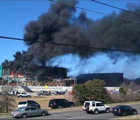 Smoke billows from a building after 53-year-old Joseph Stack piloted his small plane into it on Feb. 18, 2010. The building, which is in the same office complex as the Austin offices of the FBI, houses several government agencies, including the criminal investigation division of the IRS. (AP Photo)