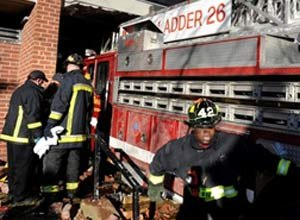 AP Photo/John Cetrino Boston firefighters work at the scene of the crash in January.