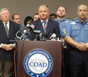 Geoffrey Klopp, center, president of the Correctional Officers Association of Delaware, speaks about a prison uprising Thursday, Feb. 2, 2017, in Dover, Del. Klopp says that he believes the uprising was due to low staffing issues at the 2,500-prisoner James T. Vaughn Correctional Center that have existed for years. (AP Photo/Brian Witte)
