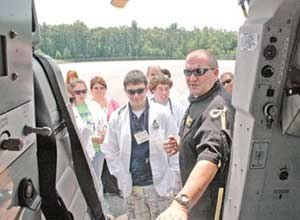 Photo courtesy of The Mount Airy NewsScott Schroat, a paramedic with AirCare, shows students the inside of the helicopter during Camp Med at Surry Community College in Dobson, N.C., on Wednesday.