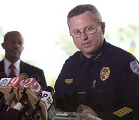 In this March 22, 2012 file photo, Sanford (Fla.) Police Chief Bill Lee speaks to the the media during as city manager Norton Bonaparte Jr. listens at left.