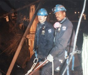 Corey Cuneo (left), with his good friend Sgt. Rodney Gillis, in the immediate aftermath of the first World Trade Center attack in 1993. They are standing beside the three-story crater left by the VBIED which rocked the building one cold February morning. Sgt. Gillis would become one of the 23 NYPD officers perish during the 9/11 attacks. (Photo courtesy of Corey Cuneo)