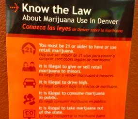 """My good friend (and former PoliceOne colleague) Hayley Hudson wrote a pretty great article about her experience on the first day of over-the-counter pot purchases in her home state of Colorado. In it, Hayley noted that there are signs with """"a bunch of legal reminders"""" like the image above posted all around Denver. (Image Courtesy of Hayley Hudson)"""