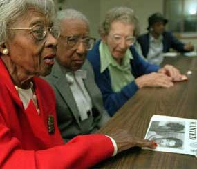 An 80-year-old woman speaks about being the victim of a scam which she reported to the Crimes Against Elderly and Retired Unit (CARE) unit of the Philadelphia Police Department. (AP Photo)