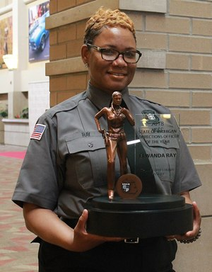 Michigan Corrections Officer of the Year Elwanda Ray with her customized award from Michigan Corrections Organization.