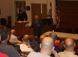 Chief Stephen Raynis outlines safety measures at the FDNY to attendees at the summit.