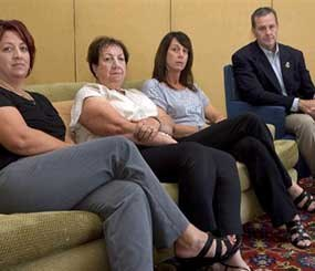 In this Sunday, Sept. 16, 2012 photo, members of Brian Terry's family, from left to right, Michelle Balogh, left, Josephine Terry, Kelly Willis and Robert Heyer, far right, pose at the Marriott-Starr Pass Resort in Tucson, Ariz.