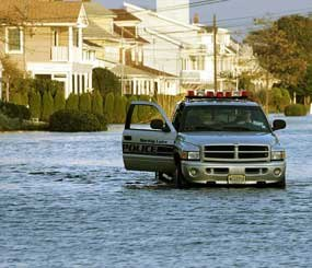 Spring Lake (New Jersey) Police Department patrols the flooded streets during a late afternoon in 2005. (AP Photo)
