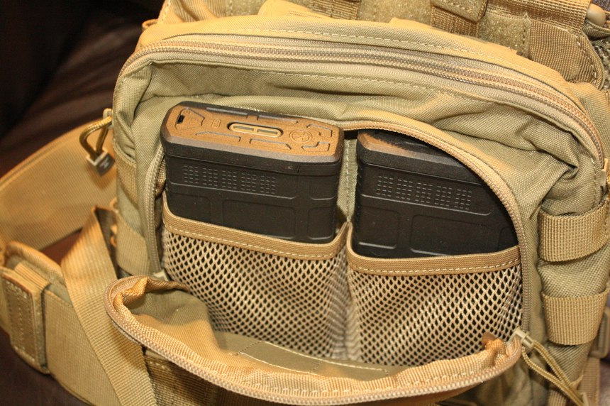The 5.11 2-Banger chest pack holds two 7.62mm P-mags in the front zippered pouch.