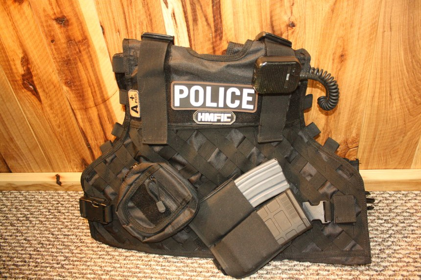 A tactical vest/body armor carrier can carry spare carbine mags and other gear in pouches added to the MOLLE strips. These elastic magazine carriers will securely hold either a 30 round M4 magazine or a 20 round 7.62mm magazine for a Designated Marksman rifle.