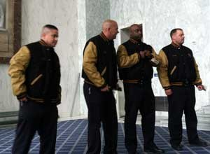 Photo PBIFirefighters Warren Deavers, Ramon Hounshell and Charles A. Ryan III along with Lt. Robert Alvarado of D.C. Fire and Emergency Medical Services Department try on their jackets awarded as part of the PBI Golden Knights.