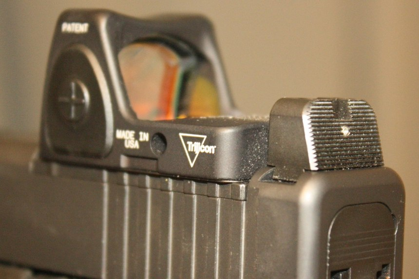 The Trijicon RMR sight was combined with the Heinie Specialty Products Straight Eight Night Sight for a co-witness sight picture. When properly zeroed, the rod dot sits perfectly atop the front iron sight, allowing iron sight use should the RMR battery fail. (Photo/Dick Fairburn)